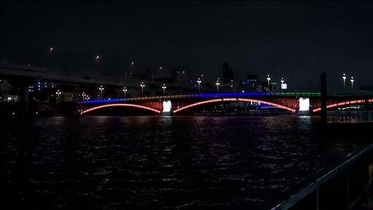 light of hope.  Tokyo was wearing the Olympic colors