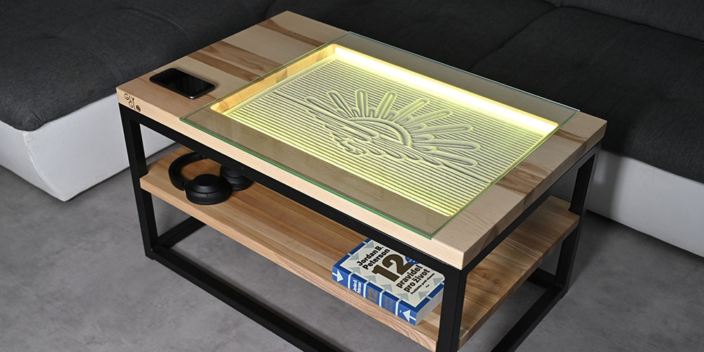 Instead of a screen, the GlyGlo smart desk drags a metal ball into the sand