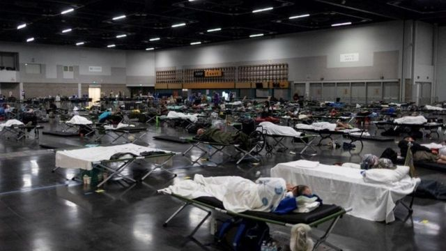 People sleep in a cooler center in Portland, Oregon, USA.