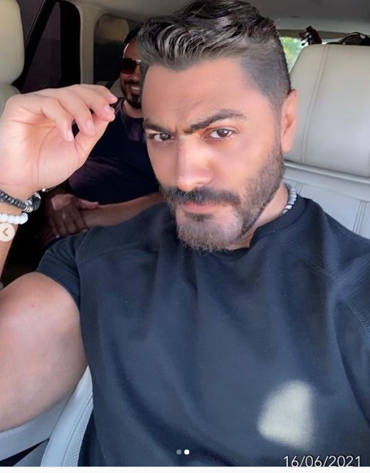 """Tamer Hosny announces the completion of filming the video clip """"Open Your Heart"""" .. Photos"""