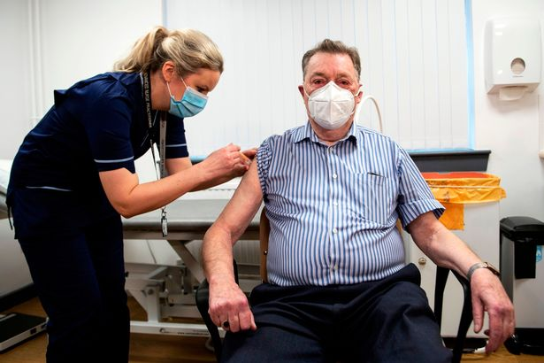 Advanced nurse coach Justin Williams (left) administers the Astrogenega / Oxford Govt-19 vaccine to 82-year-old James Shaw, the first person to be vaccinated in Scotland at the Lochi Health Center in Dundee.