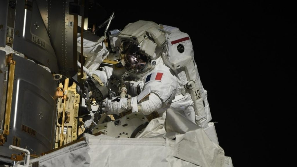 Thomas Pesquet and Shane Kimbrough leave the space station to install solar panels in the outer space