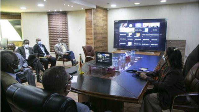 The Sudanese delegation in the Renaissance Dam negotiations participates in one of the sessions via video conference technology