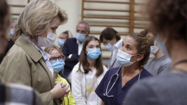 The King and Queen of Belgium inspect the affected areas