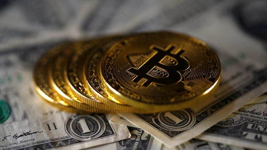 The first country will accept bitcoin as an official currency.  But most people are against it